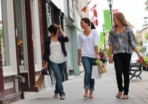 Three woemn shopping downtown Cobourg