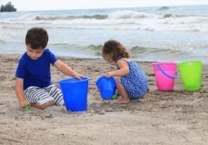 Kids playing in the sand at the beach