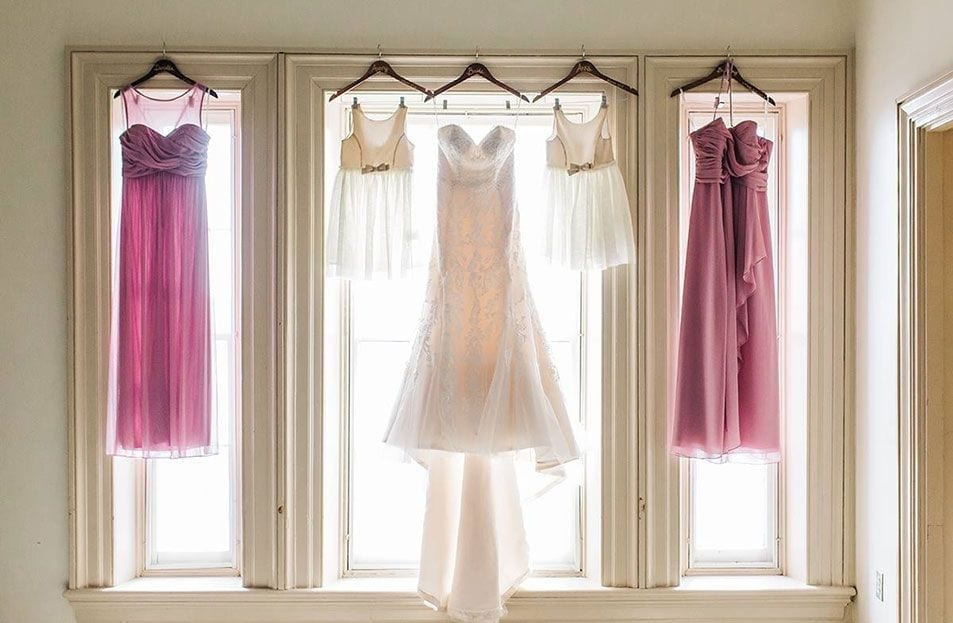 Wedding dress and bridesmaid dresses in a window